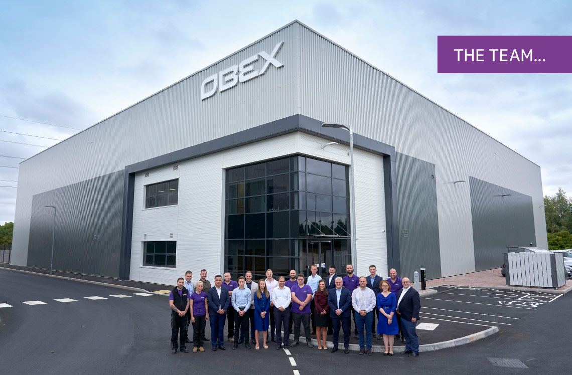 Obex Team in front of building